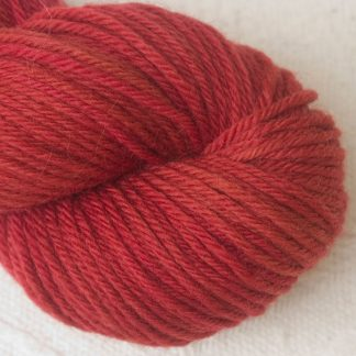 Boötes - Mid- to dark red Corriedale heavy DK/worsted weight yarn. Hand-dyed by Triskelion Studio.
