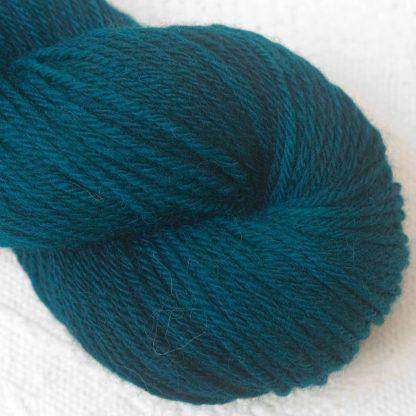 Llŷr - Dark blue green Corriedale heavy DK/worsted weight yarn. Hand-dyed by Triskelion Studio.