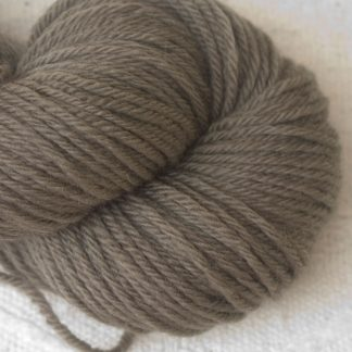 Taupe Corriedale heavy DK/worsted weight yarn. Hand-dyed by Triskelion Studio.