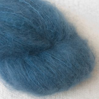 Offing - Mid-toned indigo blue suri alpaca luxury yarn. Hand-dyed by Triskelion Yarn