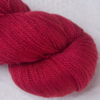 Boötes - Mid- to dark red Merino and silk blend lace weight yarn. Hand-dyed by Triskelion Yarn.