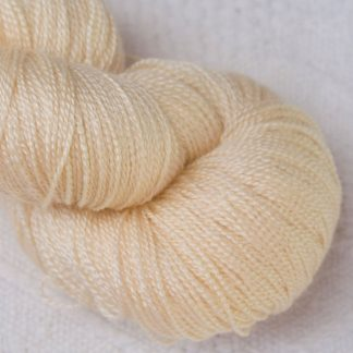 Buttermilk - Pale cream Merino and silk blend lace weight yarn. Hand-dyed by Triskelion Yarn.