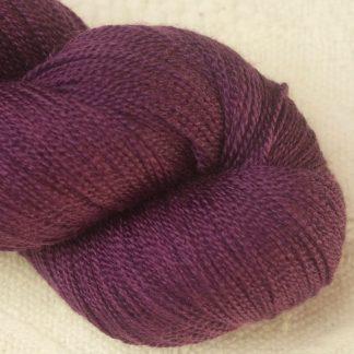 Helleborine - Dark Tyrian red-purple Merino and silk blend lace weight yarn. Hand-dyed by Triskelion Yarn.