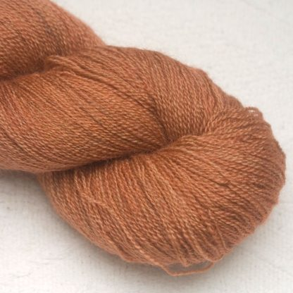 Mid-tone russet brown Bluefaced Leicester laceweight yarn hand-dyed by Triskelion Yarns