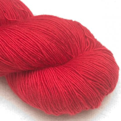 Red extra fine Falklands Merino 4-ply/ fingering weight singles yarn hand-dyed by Triskelion Yarn